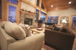 Open floor plan with gas fireplace and epic mountain views